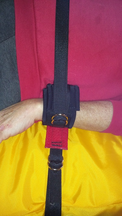 Arm Immobiliser attached to bed